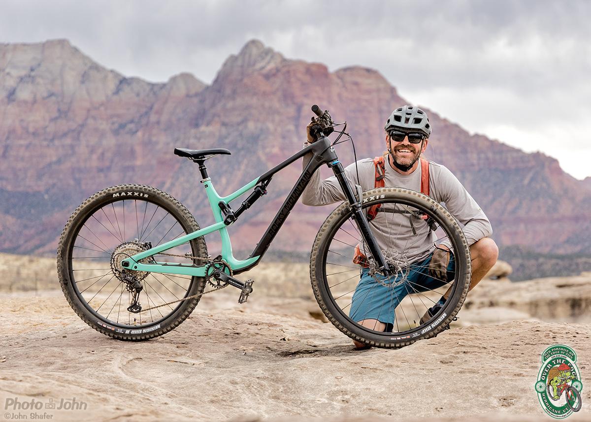 Mountain Biker and Bike with Zion Cliffs in Background